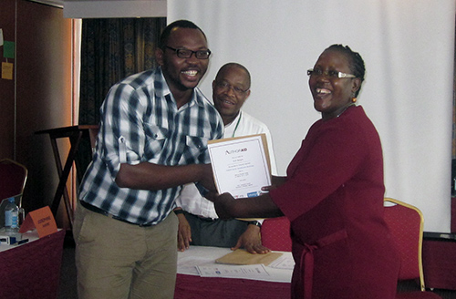 A participant receives a certificate for attending the workshop